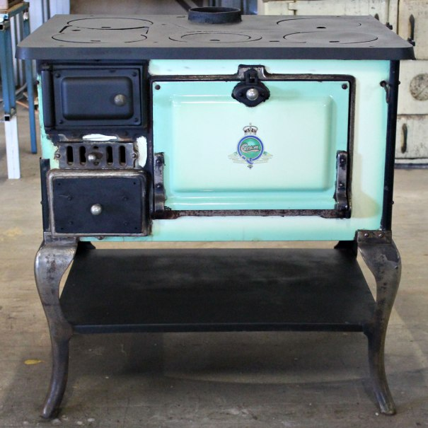 Crown No.2  Circa 1935's Colour: green with black body Dimensions: H with legs to stove top 860 (without legs 440) x W865 x D620 Features: Restored by us and ready to install.  Options: Splashback, arms and shelf $200. Legs and shelf $185.  Removable side shelf $50.  Price: $850 inc GST.  We will assist with delivery if required.
