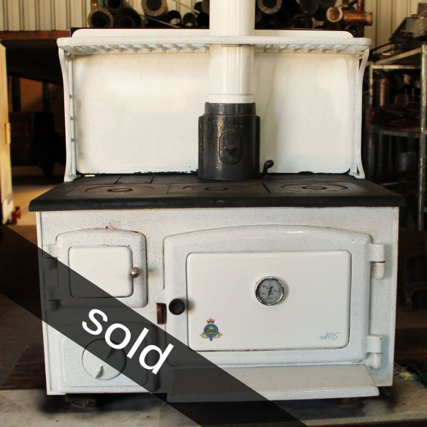 Crown No.5 Circa 1940's Colour: White Dimensions: H 490 (with splashback 940 plus legs add 440) W 885 D 525 with removal front shelf 665 Features: 3 controls (air, oven, damper), oven thermometer Options: Splashback as shown, legs and shelf Price: Wood stove $1000 Accessories (legs and shelf) $185 Splashback, arms and shelf $200 Prices quoted include GST. We will assist with delivery if required.